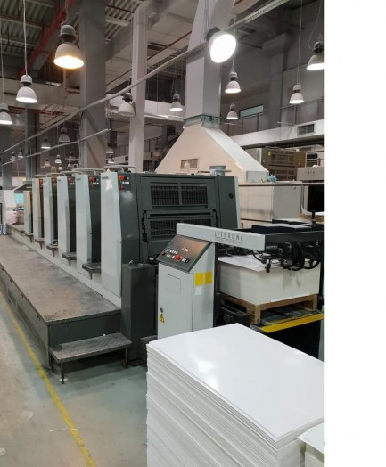 LS 529 with coater and extended delivery Komori